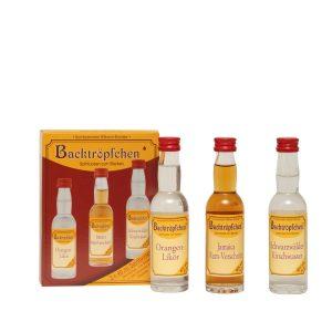 Kornbrennerei Büchter. Backtröpfchen 3 Flaschen a 40 ml. 1 Flasche Orangen-Likör, 1 Flasche Jamaica-Rum-Verschnitt und 1 Flasche Schwarzwälder Kirschwasser im praktischem 3er Pack.